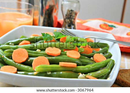 a bowl of stir fried green beans with garlic
