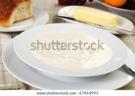 A bowl of thick creamy New England style clam chowder
