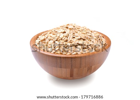 a bowl of uncooked rolled oats isolated on white background - stock photo