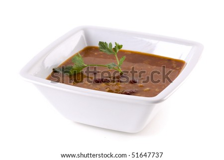 A bowl of vegetable soup on white ground - stock photo