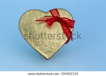 a box for a gift in the form of a heart. photo icon for valentine's day, anniversary, engagement. - stock photo