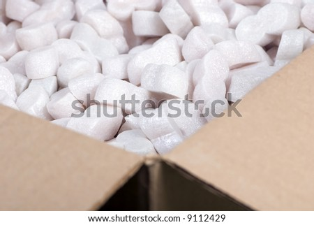 A box full of foam packing ready to ship. - stock photo