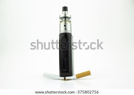 A box mod e-cigarette crushing a cigarette - stock photo