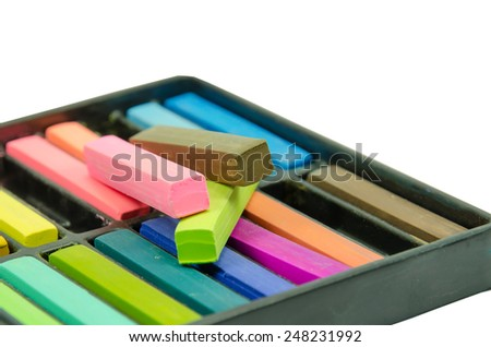 A Box of Artists Pastels on white background
