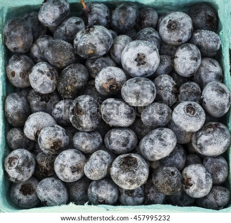 A box of just harvested blueberries at local farm market.