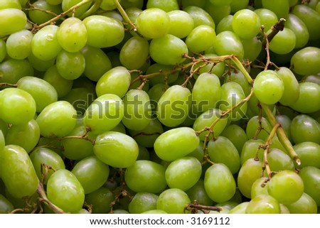 a box of organic green grapes in the market