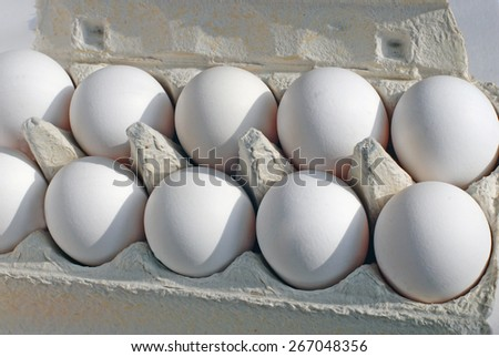 A box with eggs. - stock photo