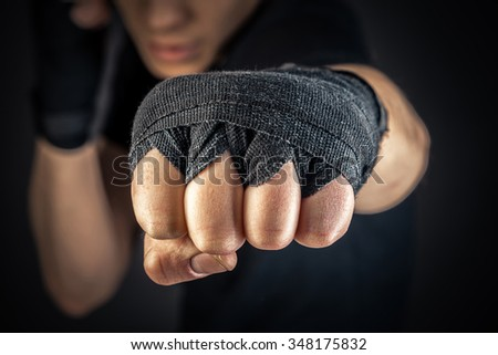a boxer's hand in wrist wraps - stock photo