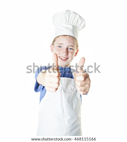 A boy cook giving a thumbs up on white