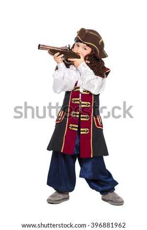 A boy dressed as pirate posing with gun. Isolated on white - stock photo
