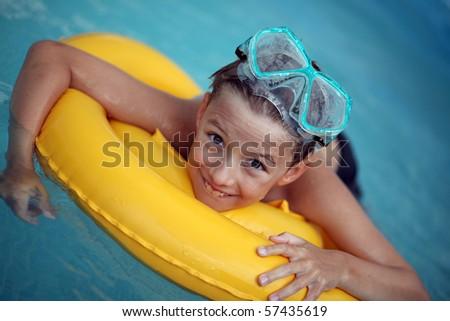 A boy having Fun in a Pool - stock photo