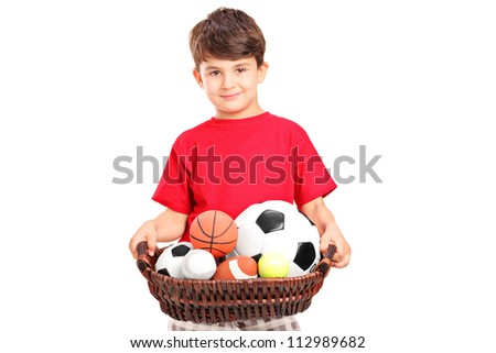 A boy holding a basket with balls, isolated on white background - stock photo