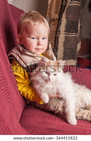 A boy hugging a cat with lots of love