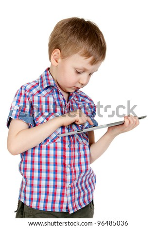 A boy in a plaid shirt with a tablet computer isolated on white background - stock photo