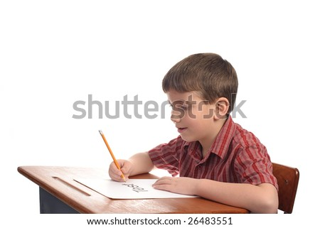 A boy in school about to take a test