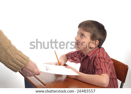A boy in school about to take a test - stock photo