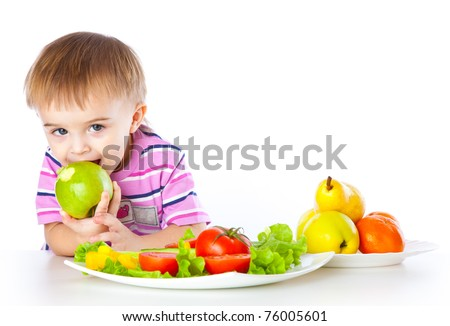 A boy is eating an apple. Isolated on a white background - stock photo