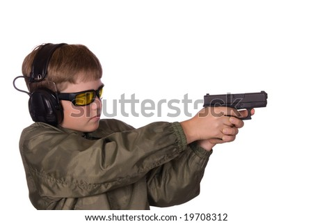A boy is prepared to go shooting by wearing his safety glasses and hearing protection.
