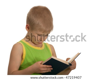 A boy is reading a book; isolated on the white background