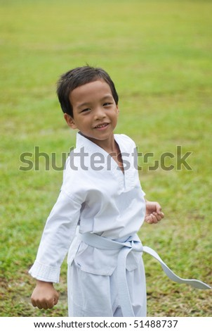 A boy make a fist style martial arts - stock photo