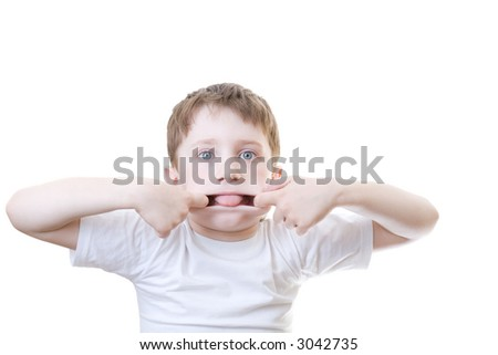 A boy making faces, isolated on white