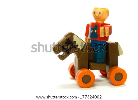 A boy ride horse toy on white background