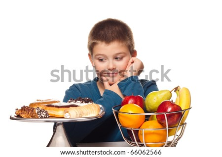 a boy's choice of a healthy or unhealthy snack - stock photo