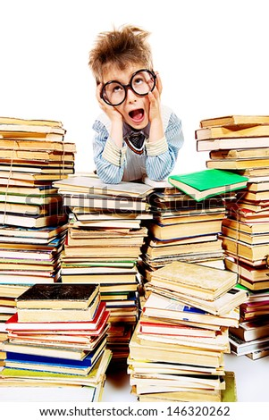 A boy sitting on a pile of books and shouting. Education. Isolated over white. - stock photo