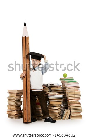 A boy standing near the pile of books and holding a huge pencil. Education. Isolated over white. - stock photo