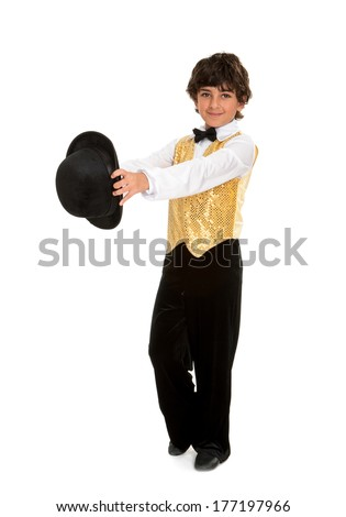 A Boy Tap Dancer Struts in a Performance Costume and Top Hat - stock photo