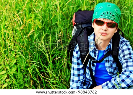 A boy teenager with knapsack posing outdoor. Tourism, active life. - stock photo