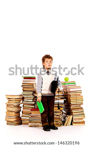 A boy with book and hat. Education. Isolated over white.