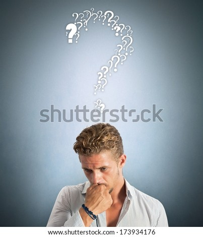 A boy with many questions about the future - stock photo