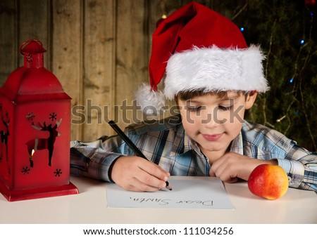 A boy writes a letter to Santa - stock photo