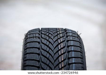 A brand new winter tire - stock photo
