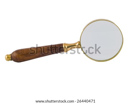 A brass and wood magnifying glass isolated on white. - stock photo