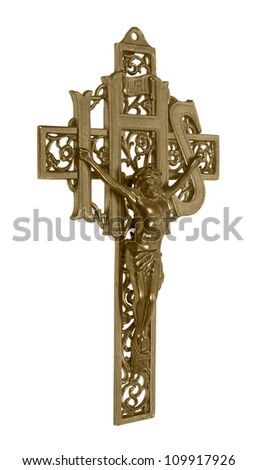 A brass cross representing a crucifix which is a Catholic symbol of their savior on a cross - path included