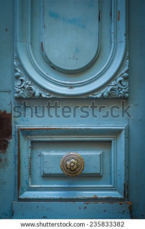 A Brass Door Knob On A Rustic Blue Door In Toulouse, France - stock photo