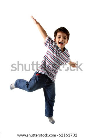 A Brazilian and caucasian kid playing on a studio with white background and isolated on white. The child is wearing jeans, shirt and shows a real expression of fun. - stock photo