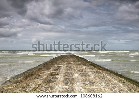 A breakwater at the Belgian coastline - stock photo