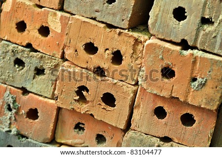 A brick is a block of ceramic material used in masonry construction, usually laid using various kinds of mortar.