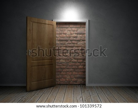 A brick wall blocking the doorway - stock photo