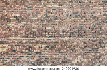 A brick wall made from red assorted bricks - stock photo