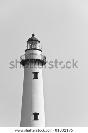 A brick white lighthouse in black and white - stock photo