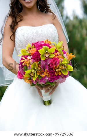 a bridal bouquet in red, pink, green, and orange - stock photo