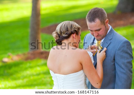 A bride and groom see each other for the first time on their wedding day and share a first look moment before the ceremony. - stock photo