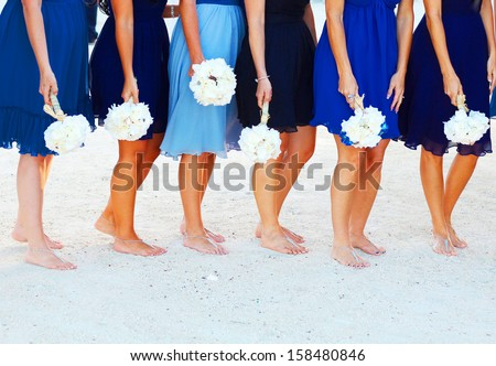 A bride and her bridesmaids holding flowers at beach in Key West Florida - stock photo