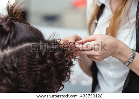 A bride at hairdressing salon before wedding.