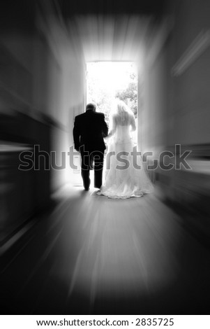 A bride & groom walk toward a new life together #2 (black & white, zoom special effect). - stock photo