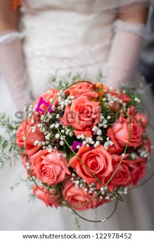 A bride, holding a bunch of flowers